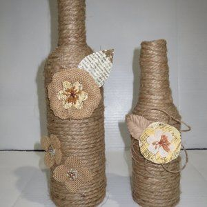 2 Jute wrapped wine bottles/vases. Burlap flowers.